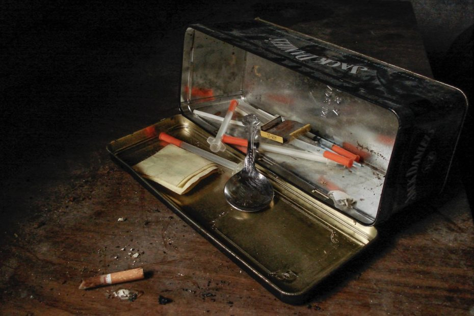 set of heroin syringes with cigarette butts